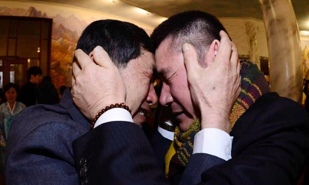 South Korean Park Yang-gon, left, and his North Korean brother Park Yang Soo get emotional as they met during the Separated Family Reunion Meeting at Diamond Mountain resort in North Korea, Thursday, Feb. 20, 2014. Elderly North and South Koreans separated for six decades are tearfully reuniting, grateful to embrace children, brothers, sisters and spouses they had thought they might never see again. (AP Photo/Korea Pool, Park Hae-soo)  KOREA OUT